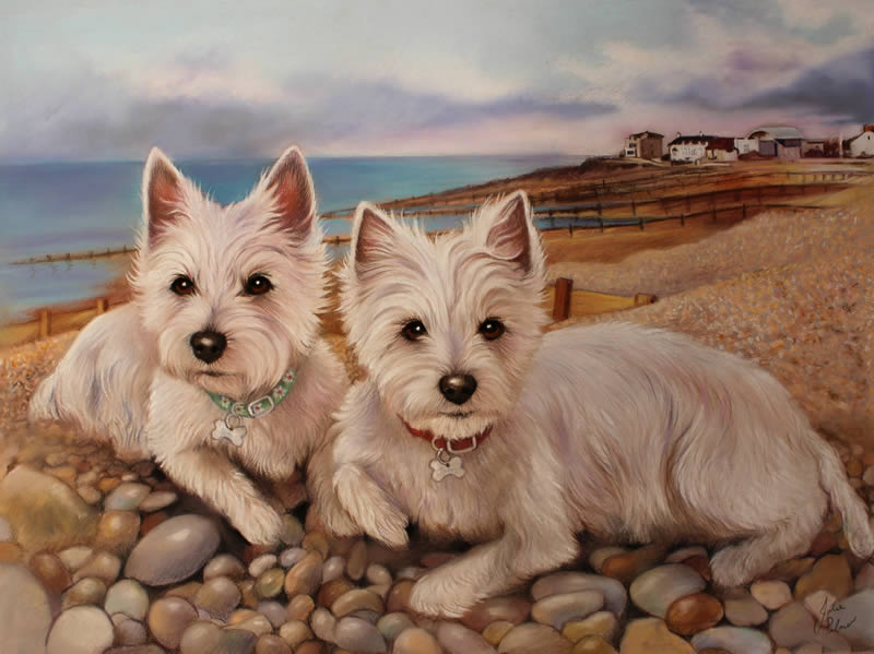 Two West Highland Terriers on the beach